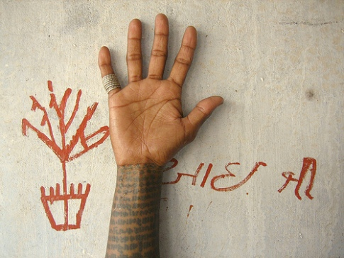 India Tribal Woman's hand shows tatoos