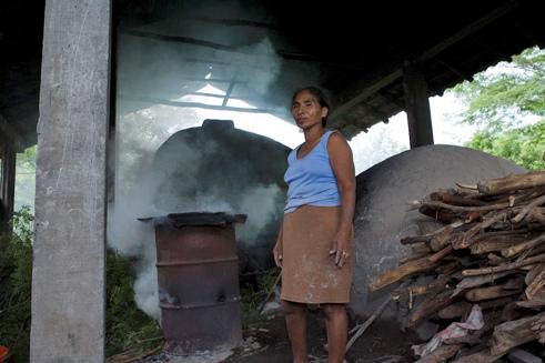 Honduras pottery woman before kiln