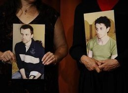 Mothers of American hikers detained in Iran hold photos of sons