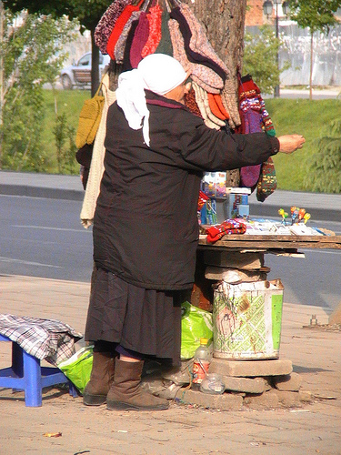 Woman selling socks in Albania's capital city, Tirana
