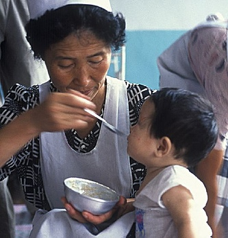 North Korea grandmother and child