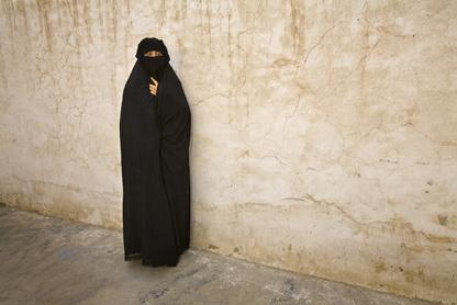 Women dressed in chaderis or burqas