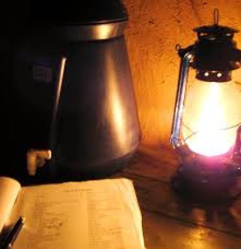 Reading by kerosene lamp in Malawi.