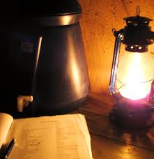 Reading by kerosene lamp in Malawi.