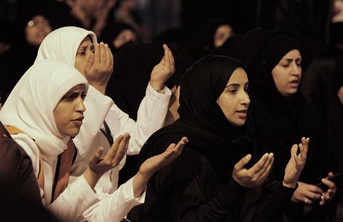 Women praying outside Bahrain hospital