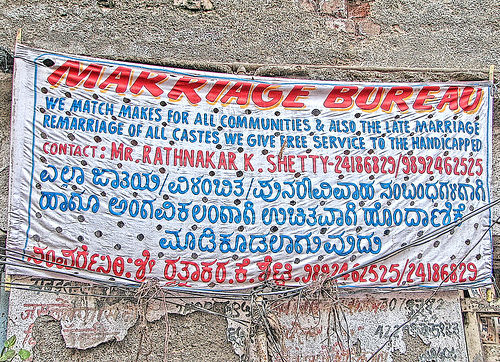 A banner sign for an arranged marriage service in Mumbai