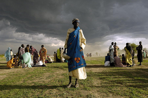 Displaced elder woman in Abyei, Sudan waits for food rations