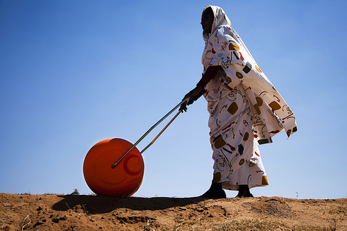 Woman in El Fasher, North Darfur walks to find water with new Hippo Water Roller