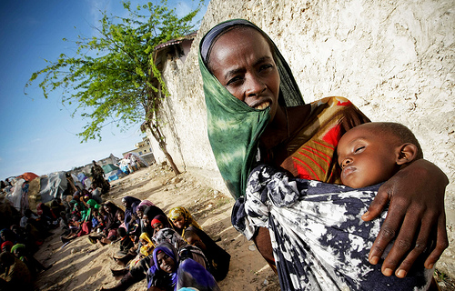 Somalia women and children wait in line for UN aid as drought conditions continue