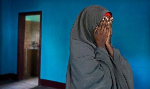 Rape victim hides her face