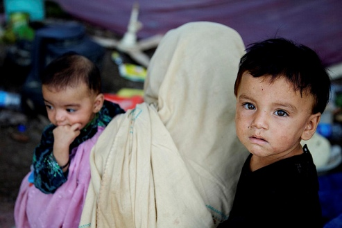 A Pakistani mother and children in a makeshift camp