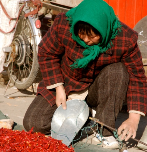 Women from Tianjin, China sells red chili peppers