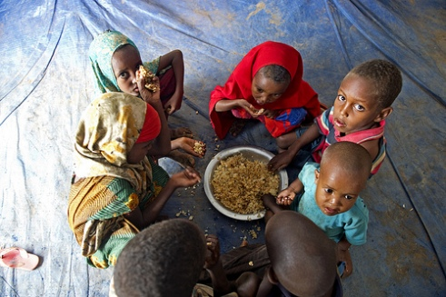 Somali refugee children share a meal inside a tent in Dollo Ado, Ethiopia.
