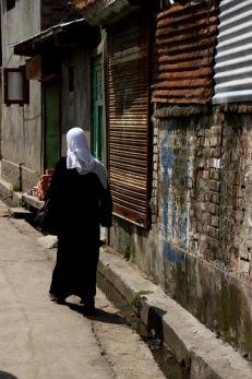 Woman walks on Srinagar street