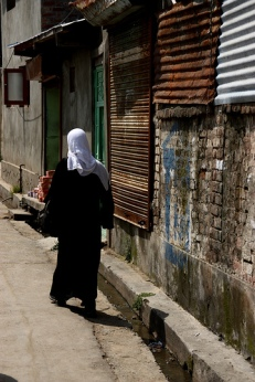 Woman walks on Srinagar street