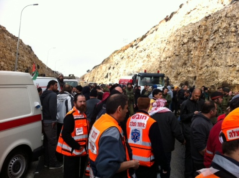 Emergency medics on the scene on the highway on the way to Ramallah.