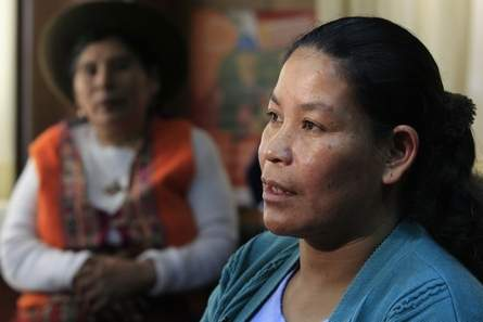 Aurelia Paccohuanca talking in a interview with another sterilization victim looking on