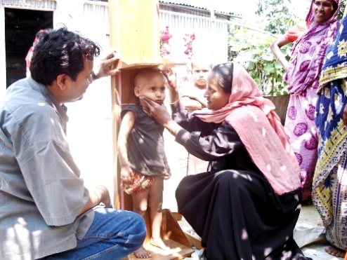 Measuring a child's height in Dhaka, Bangladesh