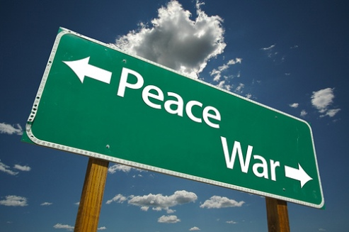 Peace in one direction, war in another -- street sign