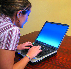 Woman typing on labtop