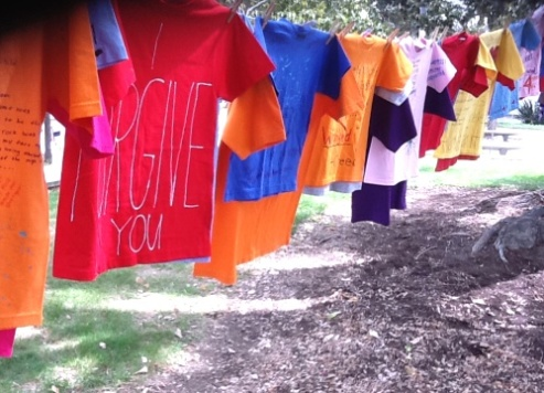 Clothesline Project - teeshirts on a clothesline installation