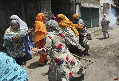 Women run from teargas during 2010 conflict in Srinagar, Kashmir