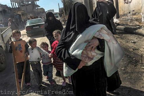 Syrian women and children flee violence