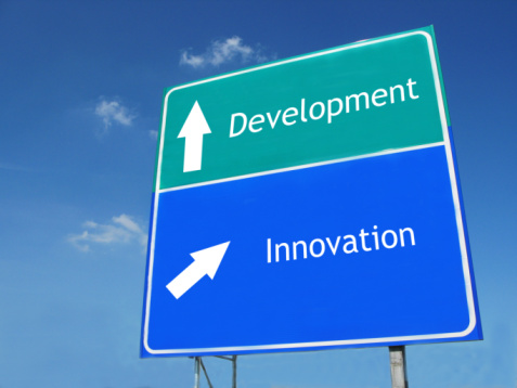 Development vs Innovation roadsign