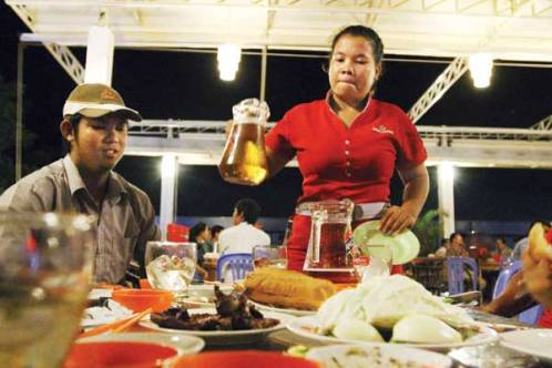 Cambodian woman beer server