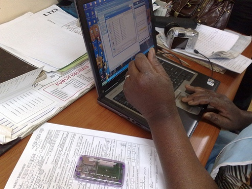 Nurse in Lusaka uses computer technology to connect to patients
