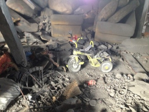 Child's bicycle in bombed out home in Gaza, November 19, 2012