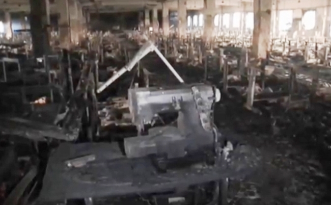 Sewing machine in burned out building near Dhaka, Bangladesh