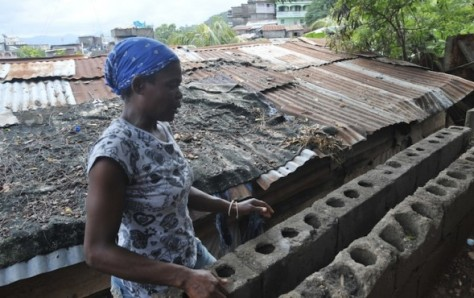 A woman working on the roof of her house