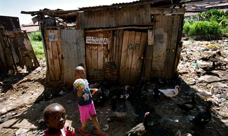 Children in front of a slum toilet