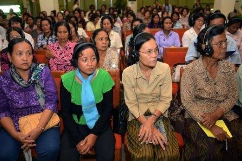 Women audience listen to stories of survivors