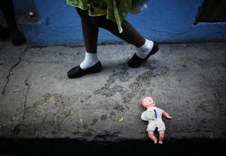 Orphanage girl with doll Port-au-Prince, Haiti