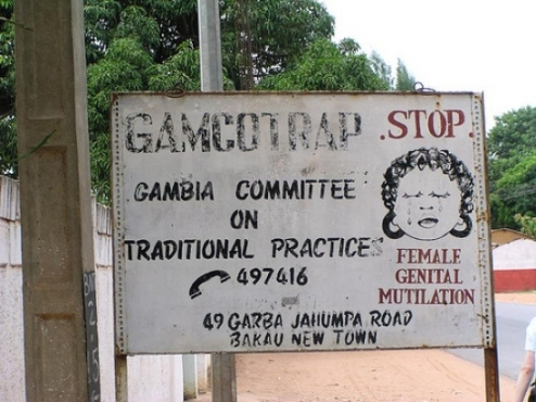 Stop FGM street sign Gambia