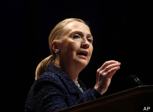 Secretary of State Hillary Rodham Clinton gestures as she gives a speech