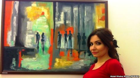 Hiba Yunis standing in front of her painting