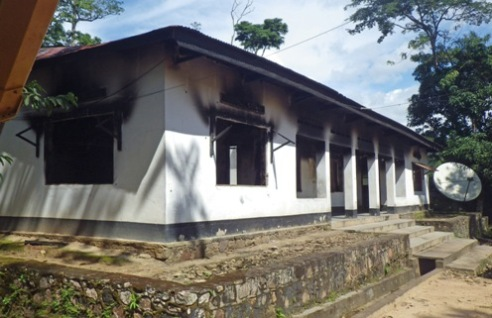 Fire pillage building in village of Epulu, Uganda June 24, 2012