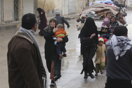 Aleppo,Syrian family rushes to shelter under missile attack
