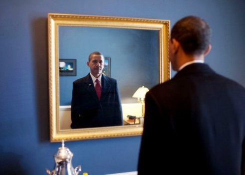 United States President Barack Obama looks into mirror