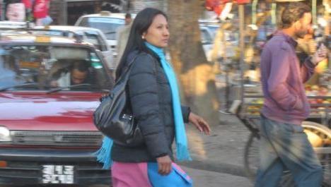 Nepali woman navigating across traffick