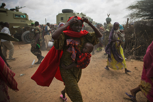 Mogadishu, Somalia refugee camp show soldiers and a refugee family