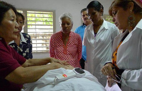 Teaching Japanese Onnetsu Therapy in Cuba.  Photo courtesy Dr. Kazuko.