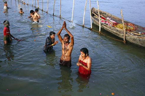 Dipping in the Ganges river during the Maha Kumbh festival in Allahabad, India