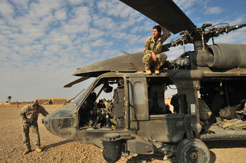Jesse Russell, a senior pilot with the 82nd Airborne sitting on helicopter in Afghanistan