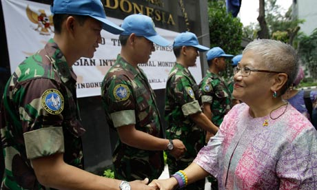 Teresita 'Ging' Quintos Deles shakes hands with soldiers