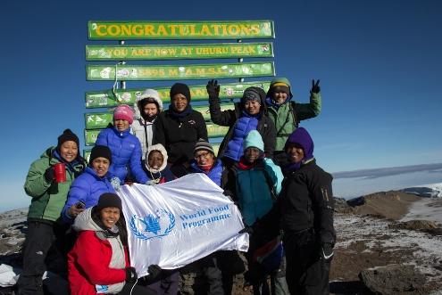 The women climbing team reaches Uhuru Peak at the top of Mount Kilimajaro in Tanzania, Africa on March 5, 2013