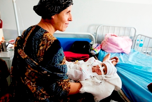 Ashawa, Iraq mother and her tiny infant